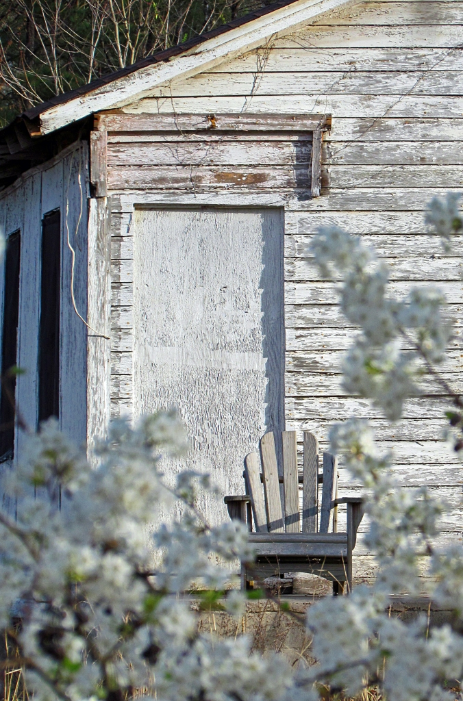 White rustic house and chair