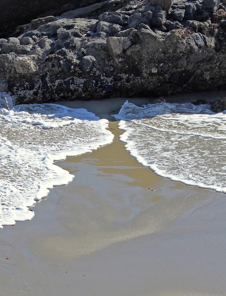 Two waves meeting at Laguna Beach California