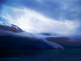 Landscape photography of a storm brewing over an alaskan glacier.