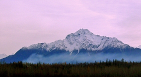 Landscape photography of snow covered Alaskan mountain.