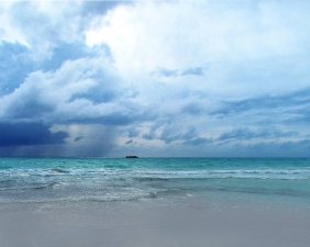 Seascape photography of a storm off Grand Bahamas Island.