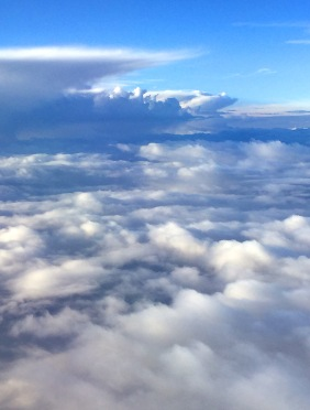 Skyscape photography of clouds from above.