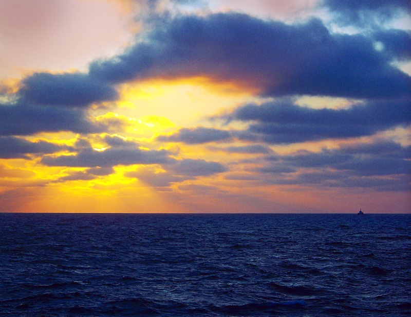 Skyscape photography of a sunset over the ocean.