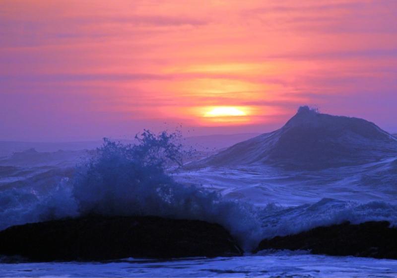 Landscape photography of splashing waves at sunset at Seal Rock, Oregon.