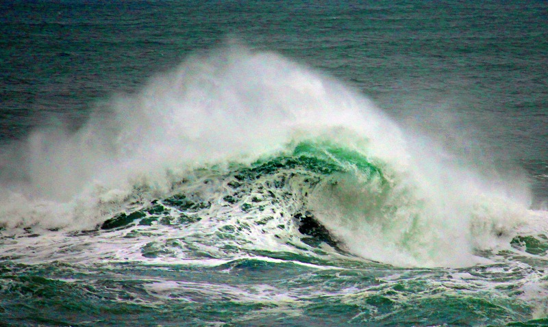 Close up seascape o\photography of the curl of a wave from Depot Bay, Oregon.