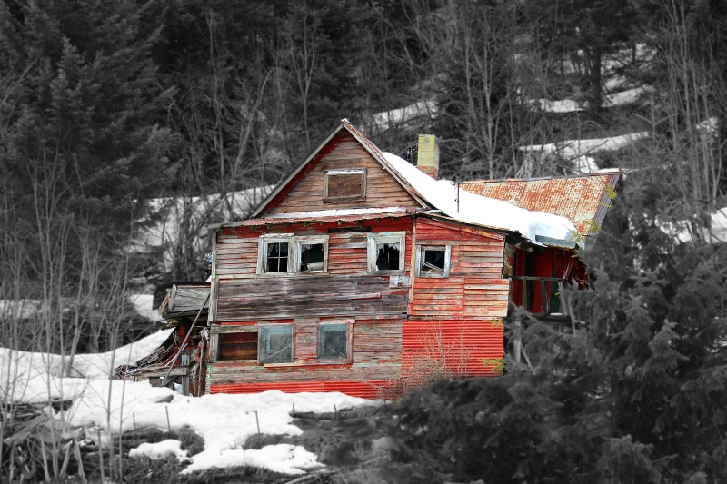 Landscape photography of an old abandoned wooden house in the mountains of Burke, Idaho.